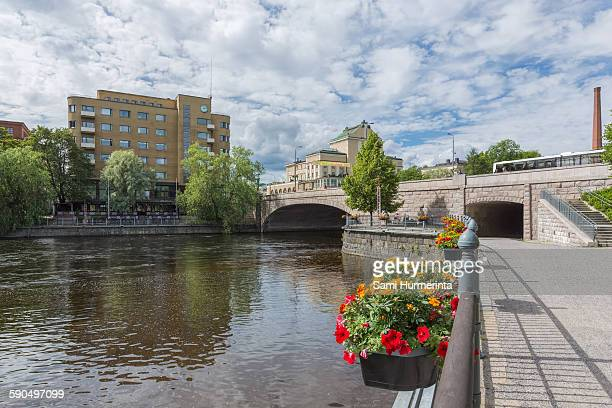 View of the Hämeensilta Bridge and the Hämeenkatu Street that cross over the Tammerkoski Rapids in the center of Tampere. The Tampere theater is...