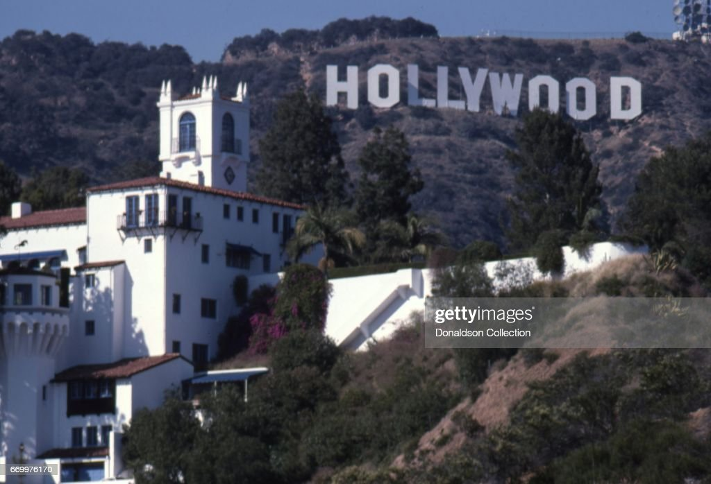 a view of the hollywood sign with a large mansion in the foreground