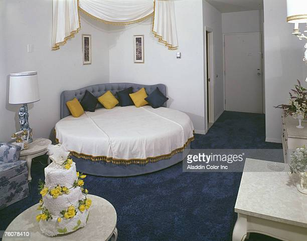 View of the honeymoon suite of an unidentified hotel 1960s A wedding cake is on a small table near the circular bed
