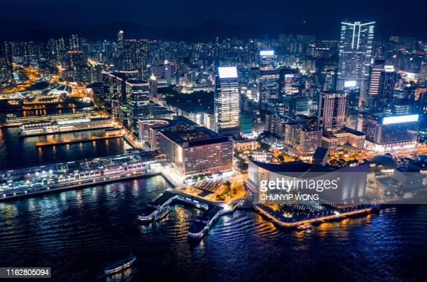 view of the hong kong at night - tsim sha tsui stock pictures, royalty-free photos & images