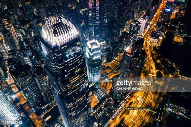 view of the hong kong at night - skyscraper stock pictures, royalty-free photos & images