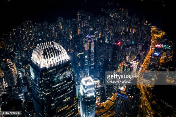 view of the hong kong at night - two international finance center stock pictures, royalty-free photos & images