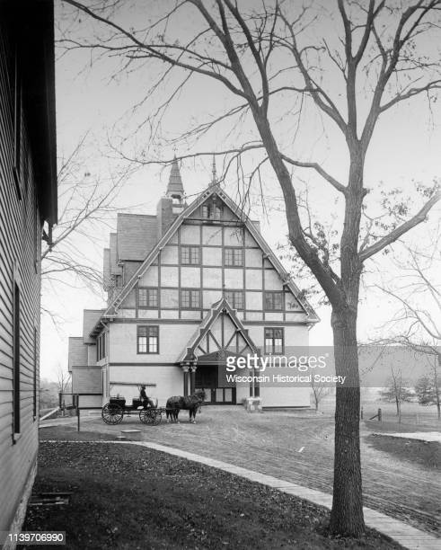 View of the Horse Barn at the College of Agriculture with a horse and buggy on the University of Wisconsin campus Madison Wisconsin 1902