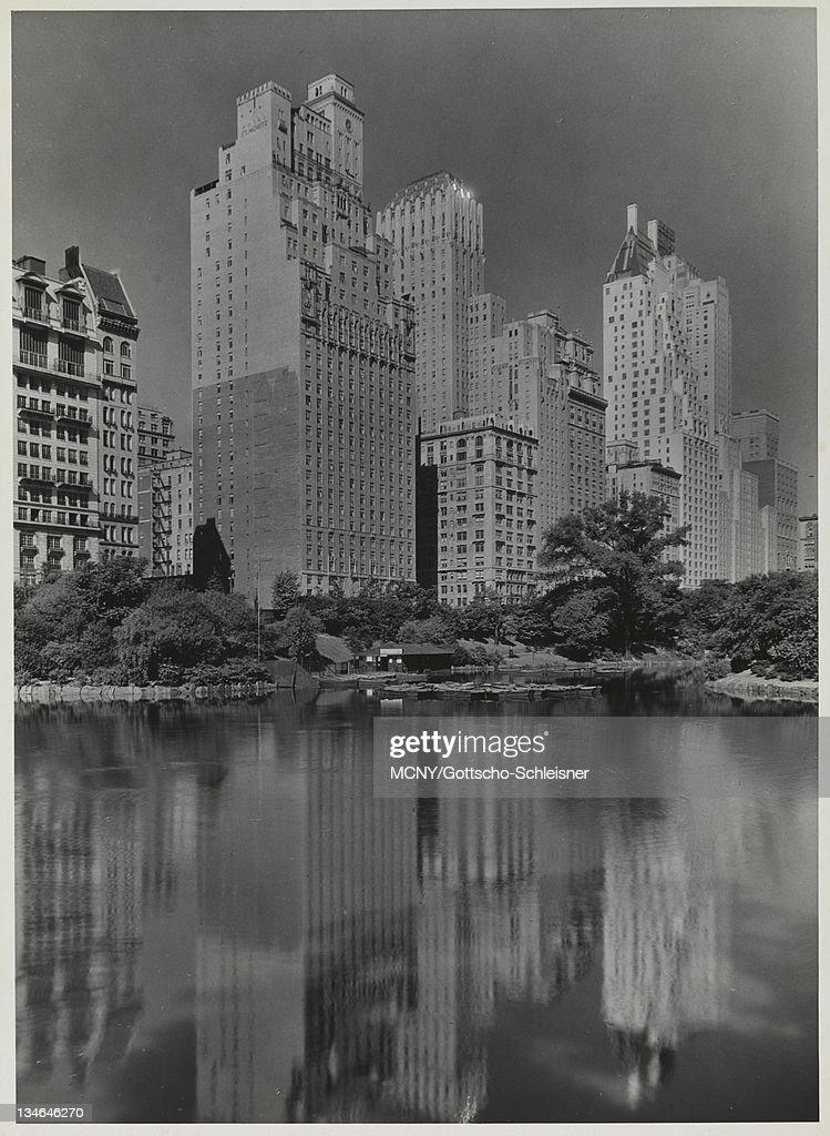 59th St Hotels Reflected In Park Lake I News Photo