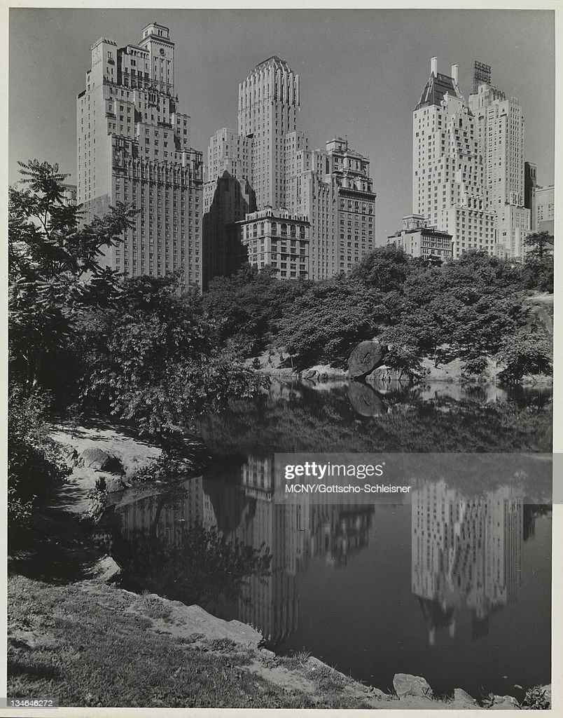 View Of The Hotels Along Central Park South And Their Reflections In Pond