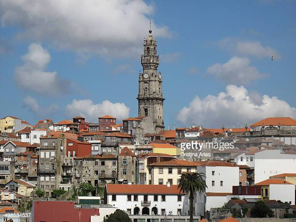 View of the houses in the old town of Oporto with the tower of the Clerigos Church highlighting over them Porto UNESCO World Heritage Site Portugal...
