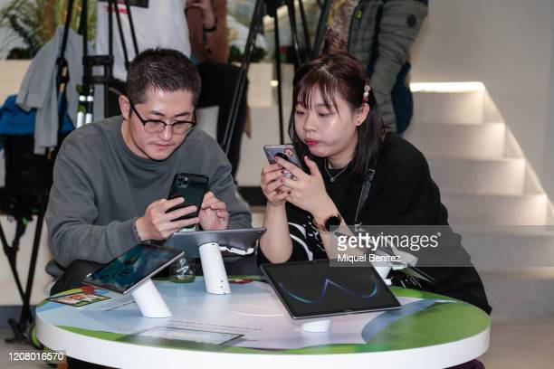 A view of the Huawei store with costumers checking products during the inauguration of Huawei Flag Ship Barcelona at Plaça Catalunya on February 22...