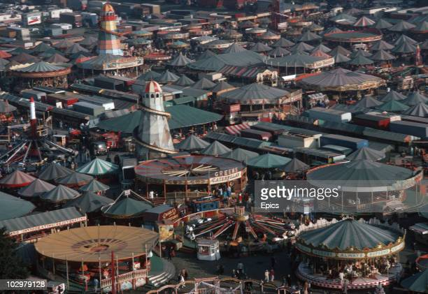 A view of the huge funfair held in Nottingham for three days every October It has its origins in in the principal hiring fair and autumn market of...