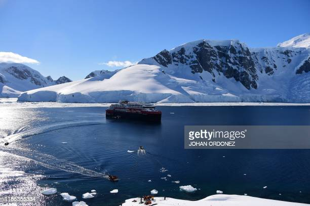 View of the Hurtigruten hybrid expedition cruise ship, MS Roald Amundsen, at Orne Harbur in the South Shetland Islands, Antarctica on November 08,...