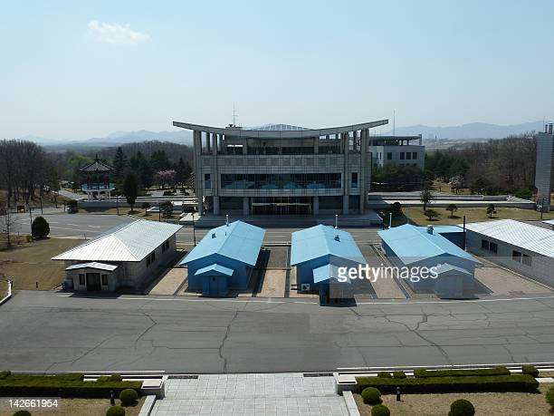 View of the huts and South Korean observation building tkaen from the North Korean side at the Panmunjom truce village in the demilitarized zone...