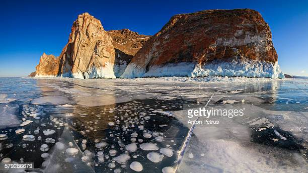 view of the icy lake and rock. lake baikal - anton petrus stock pictures, royalty-free photos & images