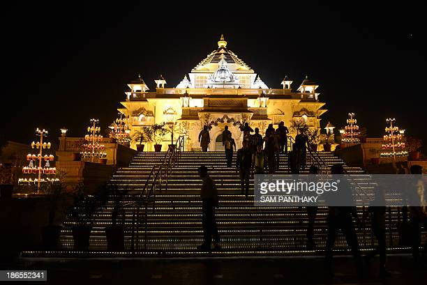 A view of the illuminated Akshardham Temple in Gandhinagar some 30 kms from Ahmedabad is pictured ahead of Diwali festivities on November 1 2013 The...