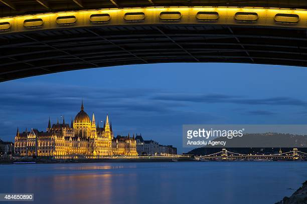 A view of the illuminated Hungarian Parliament Building on the riverside of Danube river during the Saint Stephen's Day celebrations in Budapest...