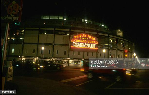 View of the illuminated marquee for Wrigley Field 'Home of the Chicago Cubs' which flashes a sign in tribute to departing Gold Glove second baseman...