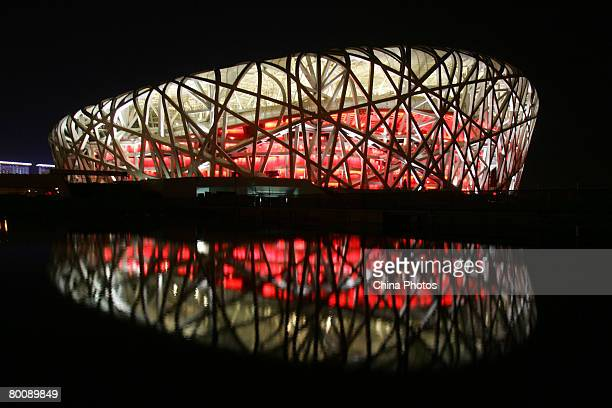 A view of the illuminated National Stadium dubbed the 'Bird's Nest' during the trial illumination of the project on March 3 2008 in Beijing China As...