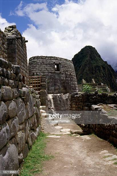 View of the Inca street leading to the circular 'Torreon' or astronomical observatory The observatory was used as the temple for the cult of the Sun...