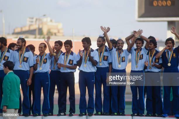 View of the India field hockey team standing together on the podium wearing their gold medals after beating Spain 4-3 in the final first place match...