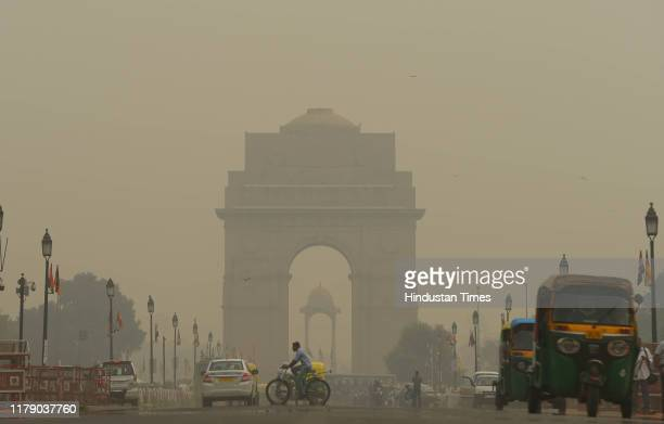 A view of the India Gate engulfed in dense smog creating low visibility at Rajpath on October 30 2019 in New Delhi India Smog that appears as a thick...