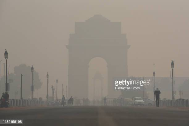 View of the India Gate engulfed in heavy smog due to rise in pollution on November 13, 2019 in New Delhi, India. The overall air quality index in...