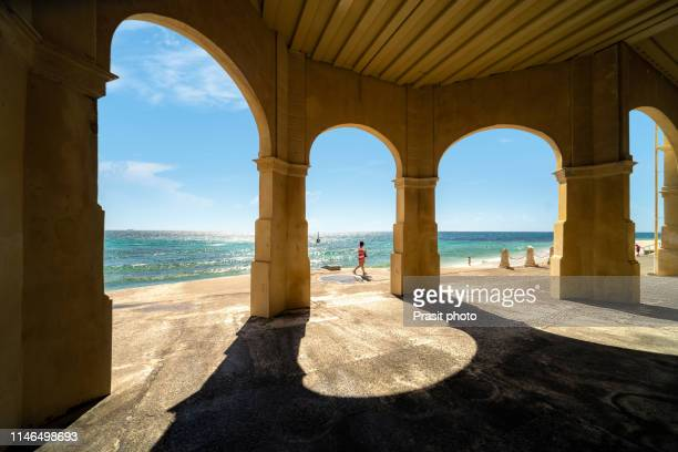 view of the india tea-rooms at cottesloe beach in perth, western australia, australia. - arch stock pictures, royalty-free photos & images
