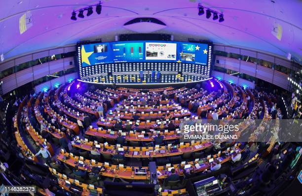 TOPSHOT A view of the inside of the European Parliament hemicycle where journalists are attending the European elections results in the European...