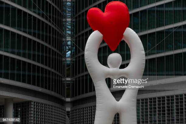 A view of the installation 'Milan Col Coeur in Man' a giant inflatable man holding a heart at Piazza Città di Lombardia on April 16 2018 in Milan...