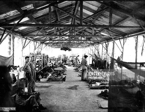 View of the interior of the former Japanese barracks converted by the Marines into a hospital on Guadalcanal, October 1942.