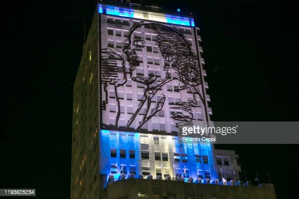 View of the iron portrait of late Eva Peron at the building now hosting the Minsters of Social Development and Health as it looks illuminated after...