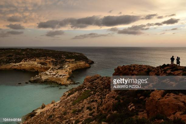 A view of the Isola dei Conigli at sunset in Lampedusa on September 25 2018 Five years after the worst shipwreck of its history the largest island of...
