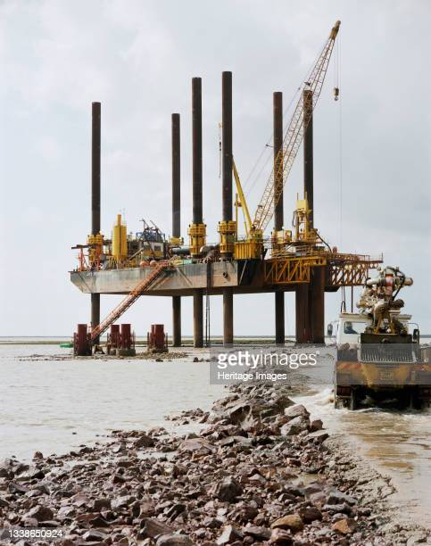 View of the 'Jay Robertson', a large jack-up barge, working in the River Severn during the construction of the Second Severn Crossing, with a...