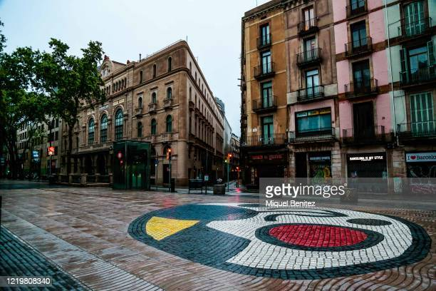 View of the Joan Miro mosaic with the Liceu theater at Rambles boulevard empty on April 19, 2020 in Barcelona, Spain. More than 20,400 people are...