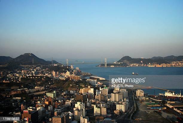 view of the kanmon bridge - 北九州市 ストックフォトと画像