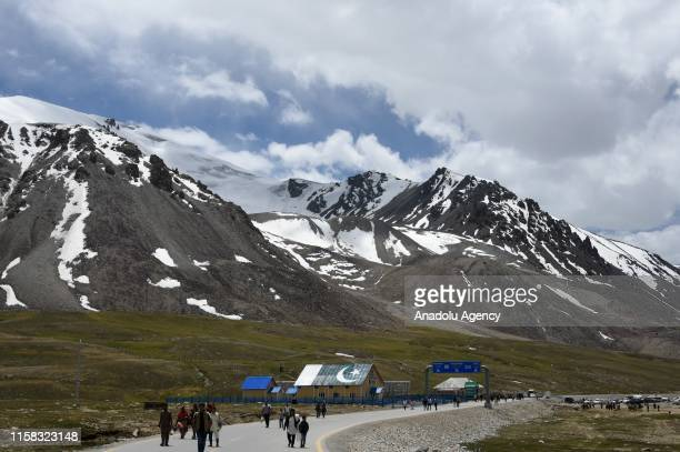 A view of the Karakorum Highway is seen as the summits of mountains are seen at the background on the Karimabad Region where a number of summits meet...