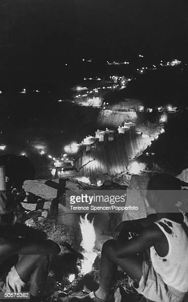 View of the Kariba Dam at night with fires burning for the villagers to appease the river god.