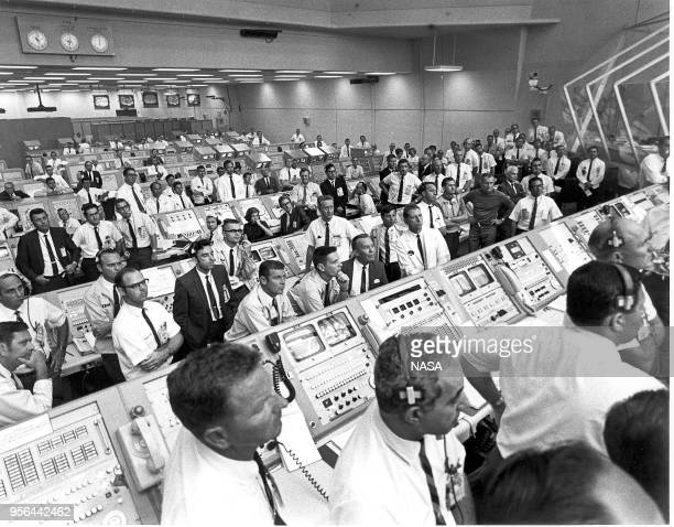 View of the Kennedy Space Center Control Room team many standing behind their consoles as they watch the liftoff of NASA's Apollo 11 mission Florida...