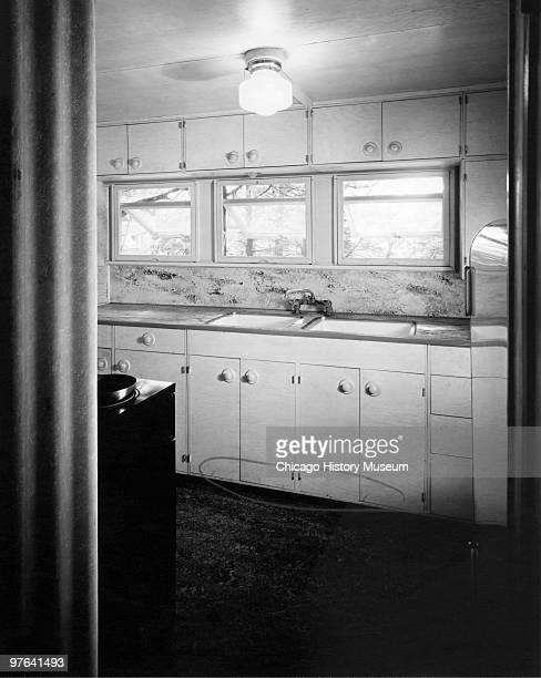 View of the kitchen in a home in Oak Ridge Tennessee July 12 1944 The city was established in 1942 to house the employees of the uraniumenrichment...