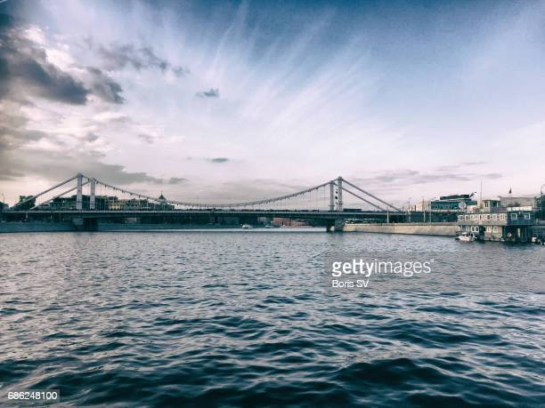 View of the Krymsky Bridge and Gorky Park from the middle of Moskva river, Moscow, Russia
