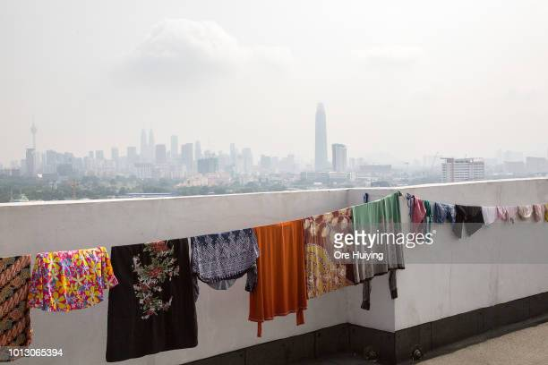 A view of the Kuala Lumpur skyline with the Tun Razak Exchange Tower in view from a residental building on July 29 2018 in Kuala Lumpur Malaysia The...