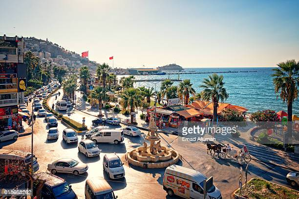 view of the kusadasi seafront promenade from one of the many hotels overlooking the seafront - izmir stock pictures, royalty-free photos & images