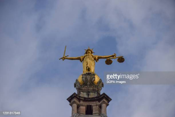 View of the Lady Justice statue on top of the Central Criminal Court, commonly known as the Old Bailey, in London.