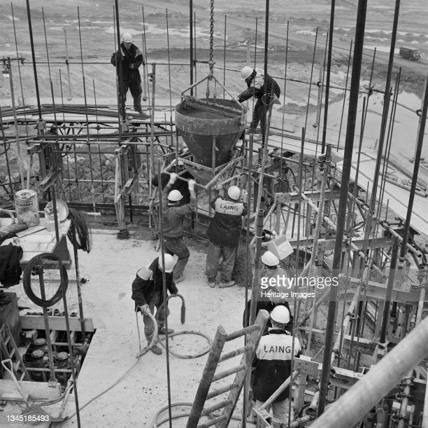 View of the Laing site team constructing the ten-sided outlet shaft at Wraysbury Reservoir, showing them on the working platform using slips to fill...