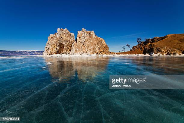 View of the lake and the icy rock. Lake Baikal.