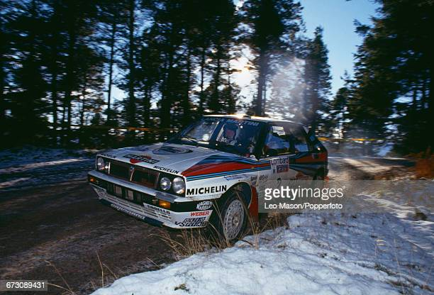 View of the Lancia Delta Integrale rally car of the Martini Racing team driven by Finnish rally driver Markku Alen with codriver and navigator Ilkka...
