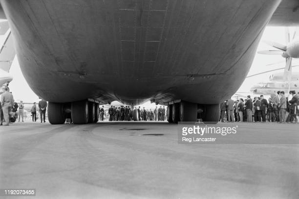 View of the landing gear and undercarriage of the prototype Soviet built Antonov An22 military transport aircraft parked on the apron during the 1965...