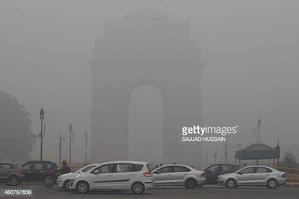 A view of the landmark India Gate monument on a cold foggy morning in New Delhi on December 22 2014 Dense winter fog enveloped the Indian capital...