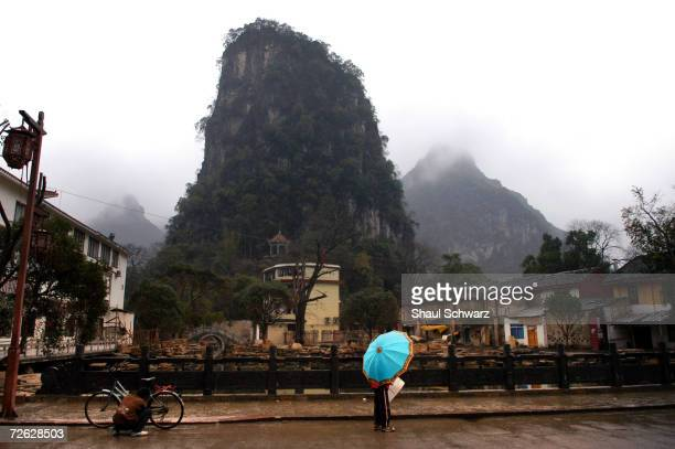 View of the landscape of towering karst formations surrounding the Li River on February 12 2004 in Yangshuo China Notorious for its stunning...
