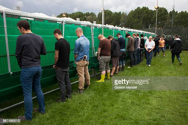 A view of the large urinal for men attending the Hackney Weekend 2012 music festival This is the UK's biggest free music event with an audience of...