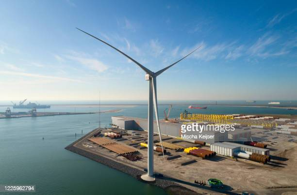 view of the larges wind turbine in the world in rotterdam harbour, the netherlands. - rotterdam stock pictures, royalty-free photos & images