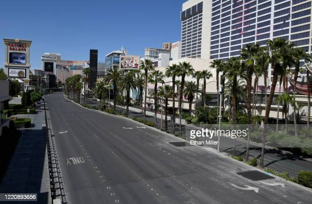 View of the Las Vegas Strip between Caesars Palace and Flamingo Las Vegas shows almost no vehicle or pedestrian traffic as the coronavirus continues...