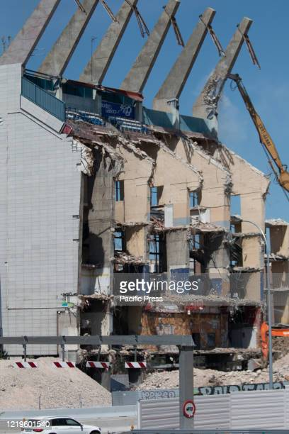 View of the last stands whit the drill machine at the end. The demolition of the last stands of Vicente Calderon stadium continue, in the past have...